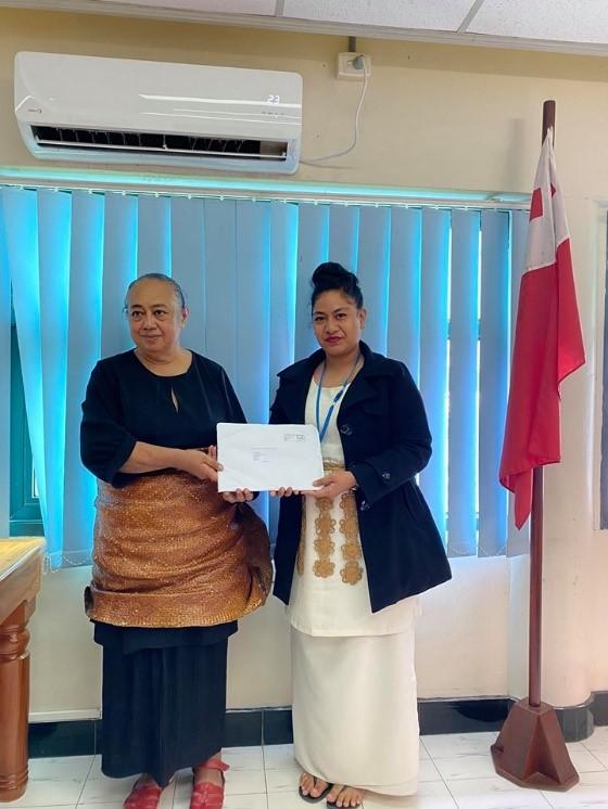 Miss. Savieti Paea receiving her scholarship package award from Madam CEO of Justice, Mrs. Temaleti. M. A. Pahulu