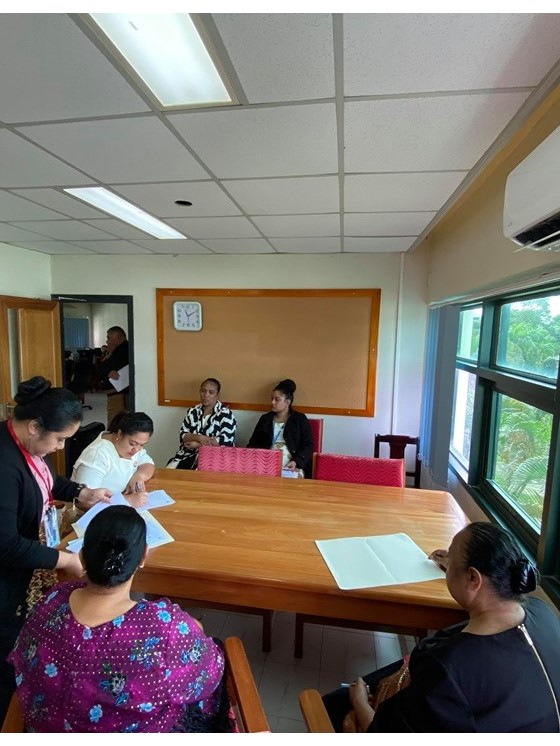 Mrs. 'Ana Fusimalohi (Acting Deputy Secretary-LLPD) assisting the scholarship recipients with signing of their contracts